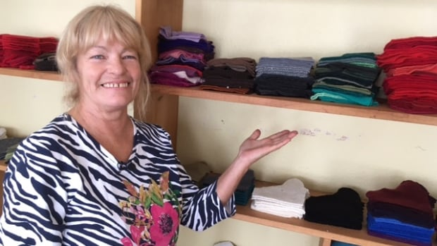 Valerie Kaulback works from her home near Murray Corner, cutting up old sweaters that will be made into mittens.