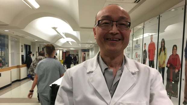Richard Li says a big smile means he is approachable to people who may need help navigating the halls at Regina General Hospital.