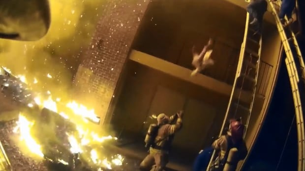 Georgia firefighter catches child dropped from burning building