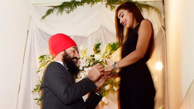 NDP Leader Jagmeet Singh proposes to Gurkiran Kaur at an engagement party in Toronto on Tuesday.