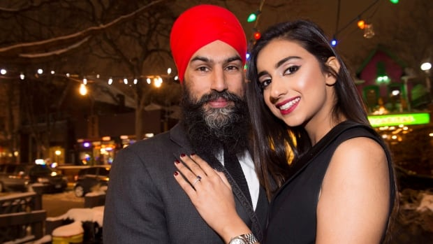 NDP Leader Jagmeet Singh poses with Gurkiran Kaur after proposing to her at an engagement party in Toronto, Tuesday January 16, 2018.