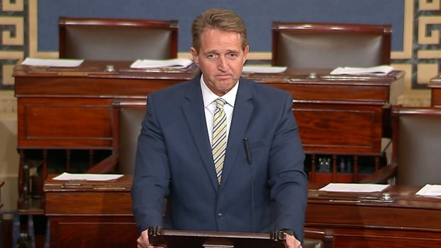 Sen. Jeff Flake, a Republican from Arizona, speaks on the Senate floor on Wednesday at the Capitol in Washington. Flake called Trump's repeated attacks on the media 'shameful' and 'repulsive.'
