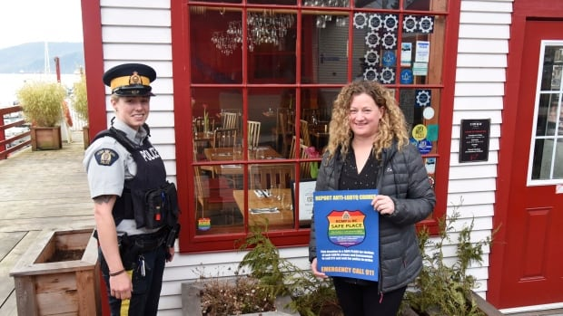 RCMP Const. Kayla Radford and Safe Place sticker campaign organizer Christine Danroth outside the Cowbay Café, one of the first businesses to sign on with the program.