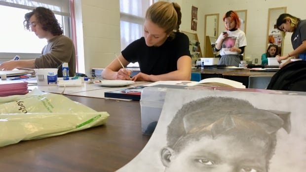 Abby Hyndman, a Grade 12 student at Colonel Gray High School, created this portrait of a child from Haiti as part of the Memory Project.