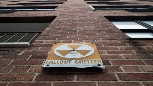 A fallout shelter sign hangs on a building on East 9th Street in New York City.