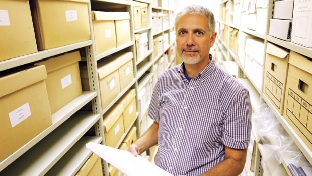 David Mawhinney is an archivist for Mount Allison University and doesn't believe the institution should phase out its top librarian.