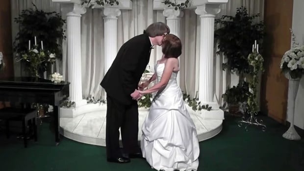 In this Oct. 29 2011 image made from a video provided by A Elvis Chapel David Turpin and his wife Louise Turpin kiss while celebrating a renewal of their wedding vows in Las Vegas. They were arrested Sunday after authorities found their malnourished