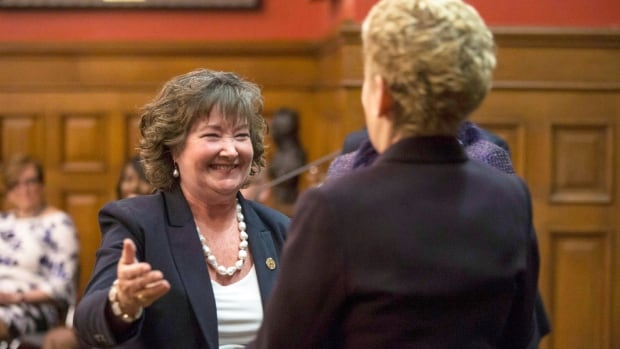 Cambridge MPP and Minister of Transportation Kathryn McGarry, left, greets Premier Kathleen Wynne during a swearing-in ceremony following a cabinet shuffle at the Ontario Legislature in Toronto on Wednesday.