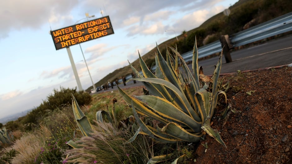 Sign warning residents of water restrictions is seen in Cape Town, South Africa. The city has now warned that they may have to turn off taps in fewer than 100 days.
