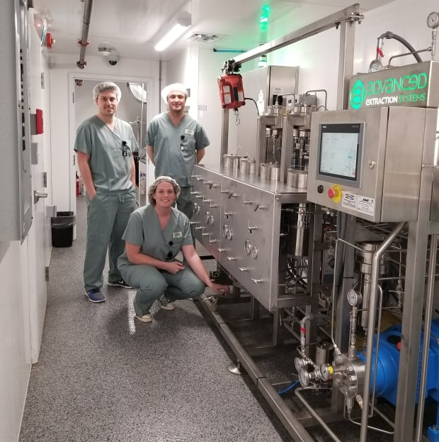 Canada's Island Garden staff with cannabis oil extraction system from Advanced Extraction Systems