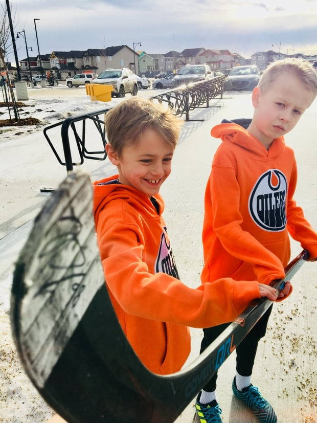 Eric Ripka (left) and Logan Green with Jesse Puljujarvi's signed stick (cbc)