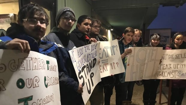 Contributors to the Shakat Journal, a Yukon publication for Indigenous youth, protested outside the Westmark Whitehorse Hotel on Thursday, calling on management to address a violent video that appears to be in the hotel entrance.