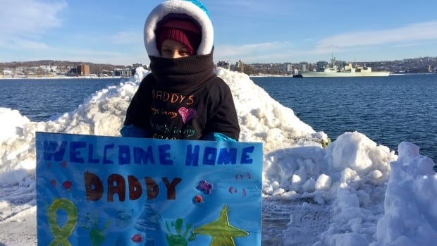 A little girl waits on the Halifax waterfront on Friday for HMCS Charlottetown to dock.