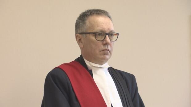 Justice Robert Stack