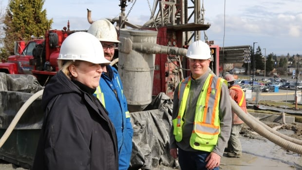 University officials and Falcon Engineering geo-exchange engineer Jeff Quibell, right, view progress on the project, which has attracted interest from as far as Scotland.