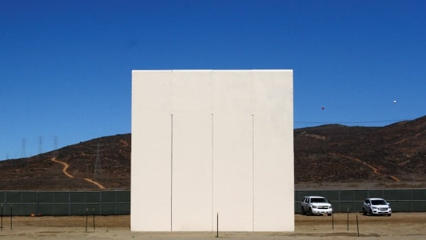 A prototype of the border wall U.S. President Donald Trump wants Mexico to pay for and which he now seems to want included in NAFTA talks. Trump's threats to scrap NAFTA suggest he also wants a protectionist wall, albeit metaphorical, between the U.S. and Canada.