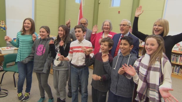 Grade 6 students from Stittsville Public School celebrate the news that a public high school is coming to their community. Standing behind them, from left to right, are Stittsville Coun. Shad Quadri, Ottawa-Carleton District School Board trustee Lynn Scott, Ottawa West-Nepean MPP Bob Chiarelli, and the board's director of education, Jennifer Adams.