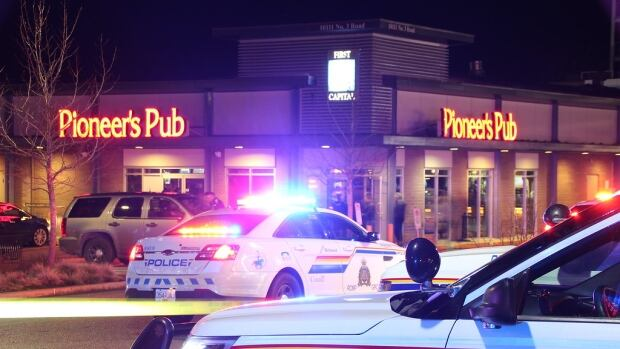 RCMP surround a pub in Richmond where a man was allegedly assaulted.