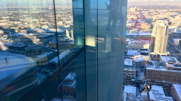 Reflections over Rogers Place from the 28 floor of the Stantec Tower under construction now in Ice District.