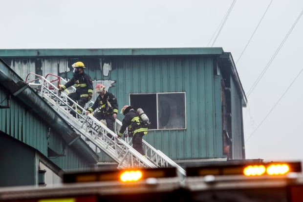 A crane tower in the sawmill was of huge concern for firefighters because of its potential to collap