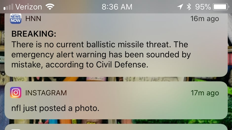 This screenshot of a cell phone shows news alerts on January 13, 2018 after the Hawaii missile warning was declared false.