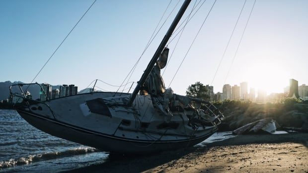 A beached sailboat lies on the shores of Vancouver's Vanier Park after a windstorm May 24.