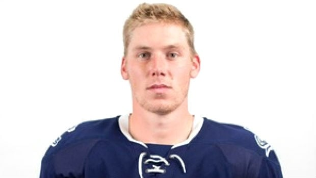 Former Mount Royal hockey captain Matthew Brown is charged in connection with a break-in at a Calgary home in which a professor was attacked.