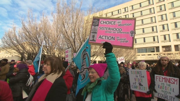 Hundreds of people gathered at Winnipeg's City Hall on Saturday, January 20, 2018, rallying for women's rights.