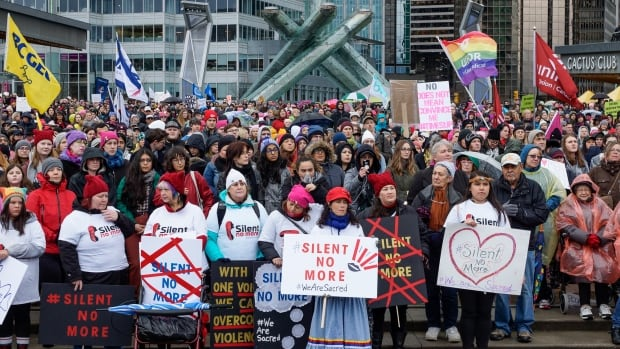 Thousands of people braved the rain to march for women's rights in downtown Vancouver Saturday.