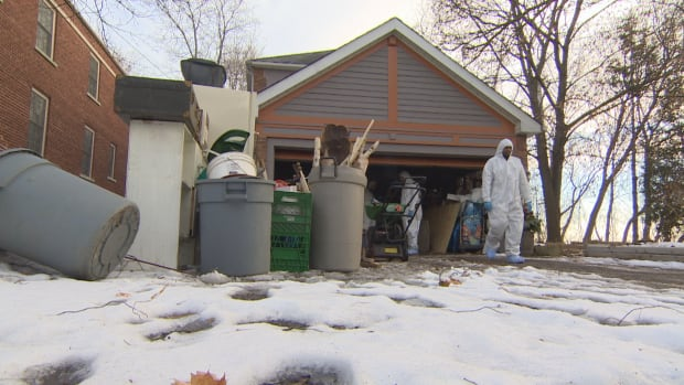 Forensic investigators in coveralls could be seen searching the garage of a home on Mallory Crescent in Toronto on Saturday.