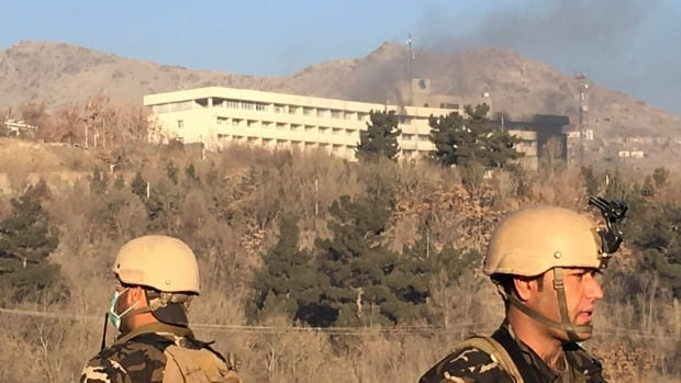 Smokes rises from the Intercontinental Hotel after an attack in Kabul, Afghanistan, on Sunday.