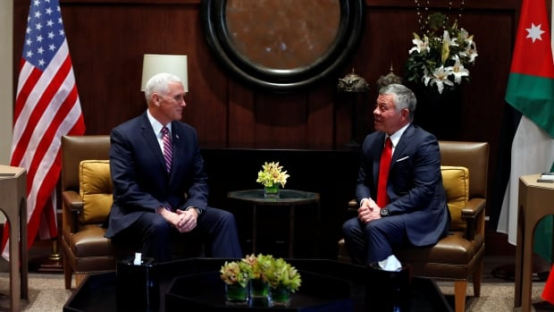 Jordan's King Abdullah met with U.S. Vice-President Mike Pence at the Royal Palace in Amman on Sunday.