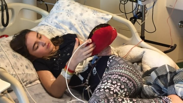 Alex Pasichnyk, 12, could be cured of a rare blood disease if the cells from the transplant take, her father says.