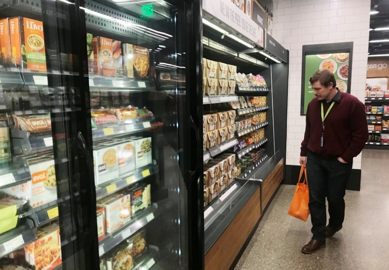 Amazon S 1st High Tech Grocery Store Opens To The Public Cbc News