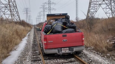 On the run from the cops, pair drives stolen pickup onto train tracks, gets stuck: OPP