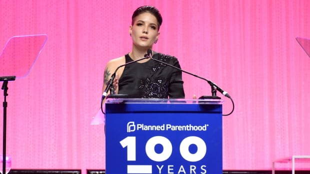 Halsey speaks onstage at the Planned Parenthood 100th Anniversary Gala in New York City in 2017. She delivered a speech at this past weekend's Women's March that recounts, among other things, a visit to a Planned Parenthood health centre when she was younger.