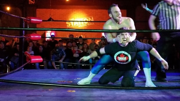 Sarnia councillor Brian White on the receiving end of a move from wrestler Sebastian Suave at a Smash Wrestling event in Sarnia on Friday, January 19th, 2018.