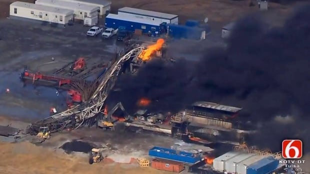 Fires burn at an eastern Oklahoma drilling rig near Quinton, Okla., Monday. Five people are missing after a fiery explosion ripped through a drilling rig, emergency officials said.