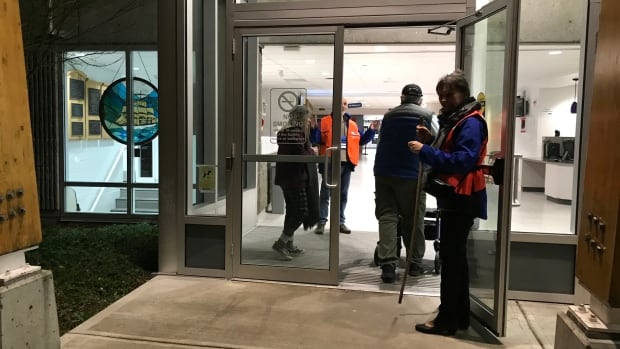 Officials in Esquimalt, B.C. welcome residents from Greater Victoria to an emergency centre set up after a tsunami warning on Tuesday, Jan. 23.