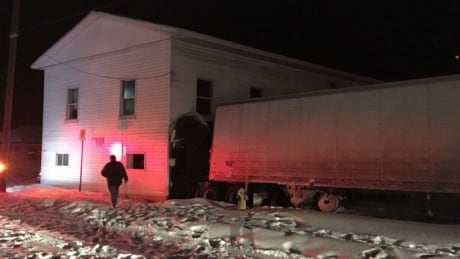 New Brunswick driver charged after tractor trailer strikes apartment near North Bay