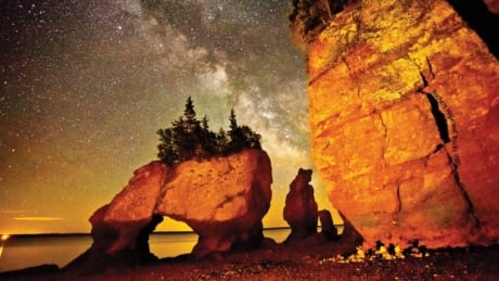 1st-time night photographer's shot of iconic rock formation lands on stamp