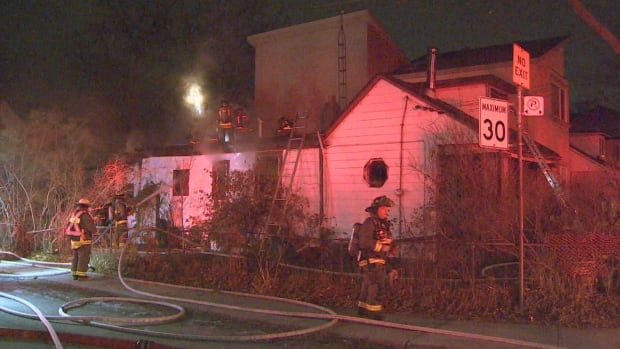 No one was injured in a house fire that broke out early Wednesday in Toronto's east end, but firefighters evacuated a home next door as a precaution, police say.