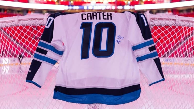 c6cba539f62 Jansen's jersey hangs on a net at the Little Caesars Arena, home to the  Detroit Red Wings, in early December. (Madison VanAntwerp/Facebook). A Winnipeg  Jets ...