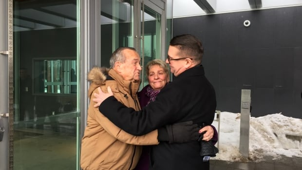 Thunder Bay Police Chief J.P. Levesque, right, embraces his parents outside the courthouse after charges of obstructing justice and breach of trust against him were dismissed.