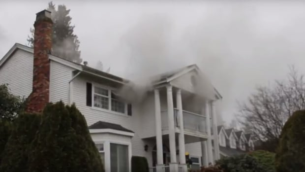 Homicide investigators called to Surrey home after two bodies found following blaze