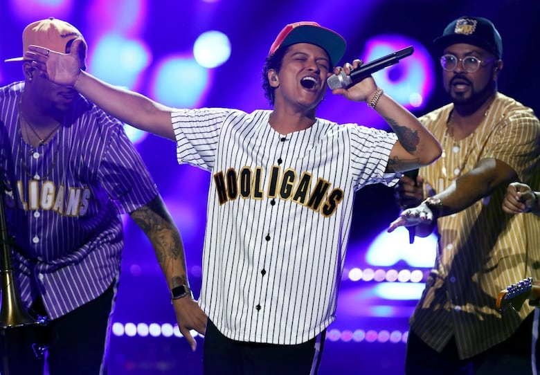 Bruno Mars is nominated for album of the year, song of the year and record of the year. (Matt Sayles/Invision/AP)