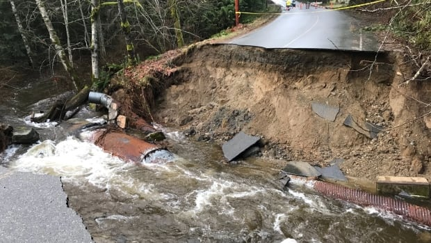A massive hole on Melrose Road in Whiskey Creek, a community located north of Nanaimo on Vancouver Island. (Oliver Watson)
