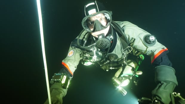 A diver from PTO Exploration braved the chilly waters of Mazinaw Lake on Saturday.
