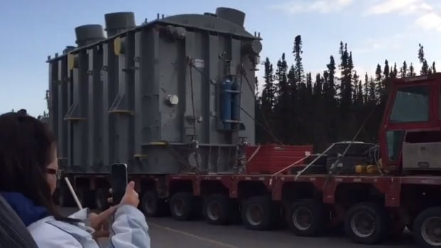 The last of seven transformers for the Muskrat Falls hydroelectric project rolls through at the gate in late August 2017.