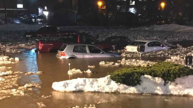 Cars surrounded by freezing flood waters in Antigonish, N.S., on Friday night.